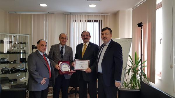 In February, chapter board members pose for a photo with SIMSOFT Company executives (l-r) Zafer Betoner, chapter vice president; Veysi İsler, Simsoft founding member; Kamil Zafer Selcuk, chapter president; and Kadir Temiz, Simsoft Company, deputy general manager.